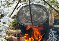 Cooking soup in a winter forest